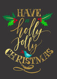 Have a Holly Jolly Christmas greetting card with hollybush Stock Photo
