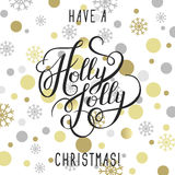 Have a holly jolly christmas! hand written calligraphy with gold Stock Image