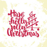 Have a holly jolly Christmas - lettering Christmas and New Year holiday calligraphy phrase  on the sketch Stock Images