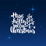 Have a holly jolly Christmas - lettering holiday calligraphy phrase isolated on the shining background with stars.. Have a holly jolly Christmas - lettering Royalty Free Stock Photo