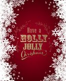 `Have a holly jolly Christmas` with lots of snowflakes Royalty Free Stock Photography