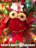 Have A Hoot This Holiday. Holiday owl sitting upon a real Walnut Tree Branch illuminated by Christmas lights Stock Photo