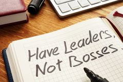 Have Leaders, Not Bosses written in a note. Leadership. Have Leaders, Not Bosses written in a note. Leadership concept stock photography
