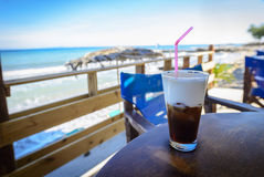 Have a little break. Delicious frappe on the beach bar with sea view. Summer vacation Stock Photography