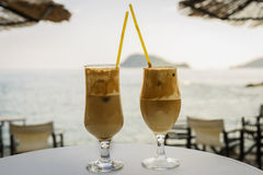 Have a little break. Two delicious frappe on the beach bar with sea view. Summer vacation Royalty Free Stock Photo