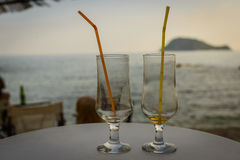 Have a little break. Two empty glasses on the beach bar with sea view.  Summer vacation Royalty Free Stock Image