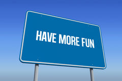 Have more fun against bright blue sky. The word have more fun and blue billboard against bright blue sky Stock Photos