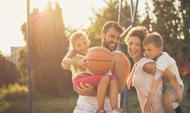 They have the most fun as a family. Family on basketball court stock image