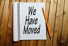 We have moved word. On notepad Royalty Free Stock Images