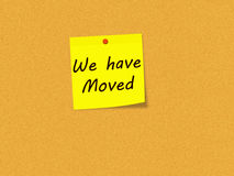 We have Moved on Yellow Sticky note on Corkboard Royalty Free Stock Image