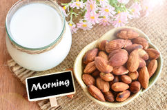 Have a nice day with almond and almond milk. Have a nice day with almond and almond milk on sack background royalty free stock photos