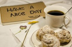 Have a nice day. Breakfast in bed with coffee, biscuits and flowers. Have a nice day concept. Start your morning with a smile on your face stock image