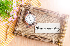 Have a nice day card and pocket watch at 6 AM. Stock Photos