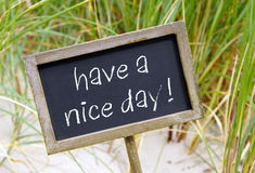 Have a nice day - chalkboard with text at the beach. Greeting and communication stock photos