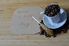 Have a nice day, and coffee beans Royalty Free Stock Images
