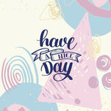 Have a nice day hand lettering phrase on abstract background Stock Photo