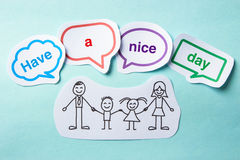 Have a nice day. Happy paper family with speech bubbles of Have a nice day concept on the blue background royalty free stock photo