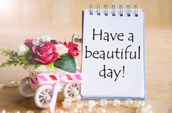Have a nice day on open diary and and red rose. Stock Image