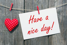 Have a nice day - red heart with postcard Stock Photo