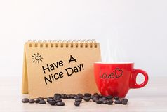 Have a nice day and red hot coffee cup Stock Photo