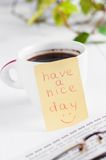 Have a nice day with smile and cup coffe Stock Images