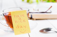 Have a nice day with smile and cup tea Royalty Free Stock Image
