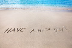 Have a nice day. Text on the beach royalty free stock photos