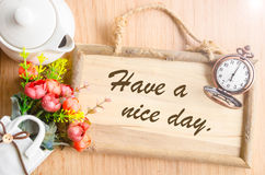 Have a nice day text in blank wooden photo frame Royalty Free Stock Photo