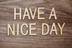 Have a Nice Day text message on wooden background stock photography