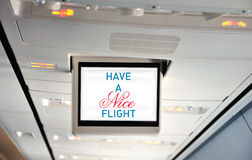 Have a nice flight. This photograph represents an commercial aircraft interior - monitor with message: Have a nice flight Stock Photo