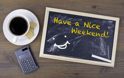 Have a Nice Weekend! Chalk board on a wooden table royalty free stock images