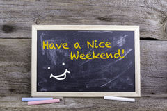 Have a Nice Weekend! Chalk board on a wooden table Royalty Free Stock Image