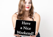 Have a nice weekend written on virtual screen. technology, internet and networking concept. beautiful woman with bare Stock Photo
