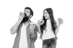We have passion for tasty doughnuts. Father and small daughter eating glazed doughnuts. Bearded man and little girl stock photo