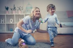 Have play with Mom. Little baby boy. Childhood royalty free stock image