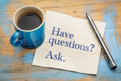 Have questions? Ask. Handwriting on a napkin with a cup of espresso coffee Stock Photo