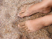 Have a rest. A woman rests foot on the seacoast royalty free stock image
