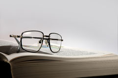 Have a rest and esteem …. Is tired to read. Has put on the book glasses Stock Photos
