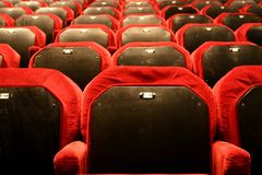 Have a seat?. Empty seat in a theater Royalty Free Stock Photography