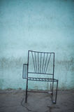 Have a Seat. Crumbling building and tattored chair on the streets of Havana, Cuba Stock Images