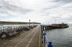 Have a seat on the swanage pier Royalty Free Stock Image
