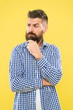 Have some doubts. Thoughtful expression. Need to think. Thoughtful man hesitating making decision. Hipster bearded face royalty free stock photo