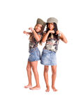 We Have Something To Say. Two little African American girls dressed in denim skirts and military woodland camouflage tops and caps with something to say Stock Photography