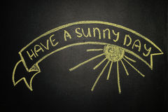 Have a sunny day with Ribbon Banner, written with chalk on a bla Stock Photo