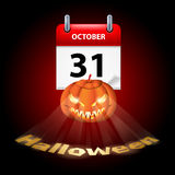 Have a very scary Halloween!. Halloween concept with shining spooky pumpkin and calendar on 31th of October Royalty Free Stock Photo