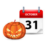 Have a very scary Halloween!. Halloween concept with spooky pumpkin and calendar on 31th of October over white Royalty Free Stock Photography