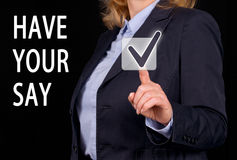 Have your say business concept. Hand of a businesswoman touching an interactive screen with have your say text Stock Photo