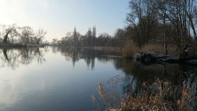 Havel River landscape (Brandenburg, Germany) at winter time with snow and ice. flowing water.  stock footage