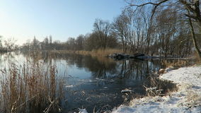 Havel River landscape (Brandenburg, Germany) at winter time with snow and ice. flowing water.  stock video footage