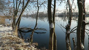 Havel River landscape (Brandenburg, Germany) at winter time with snow and ice. flowing water.  stock video